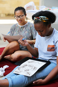 YAYA Giovanni Houston (Textiles and Fashion Design) and Penny Xiong (Art History) working with henna on paper.