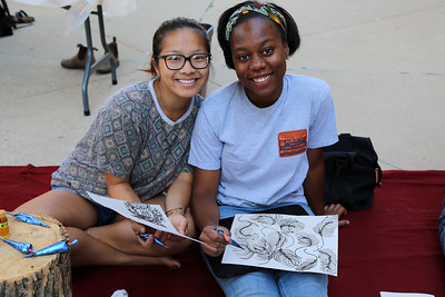 YAYA Giovanni Houston (Textiles and Fashion Design) and Penny Xiong Penny Xiong (Art History) take a break from their work to smile for the camera.