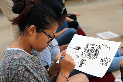 Penny Xiong (Art History) practicing henna on paper.