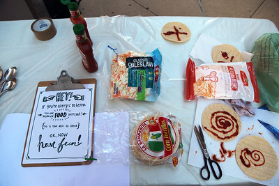 In addition to Henna, participants could create images on tortillas using sauce.