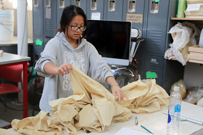 Time to create! Penny Xiong (Art History) picks out her fabric for the day's class.