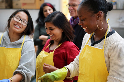 Penny Xiong (Art History) and YAYA Giovanni Houston (Textiles and Fashion Design) share a laugh with Meeta. Sarah K Khan and Professor Henry Drewal look on.