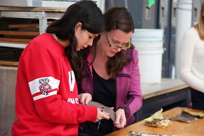 Catherine Finedore (COE, Biomedical Engineering) and Sarah O'Farrell (MFA, Art) examine a piece of work.
