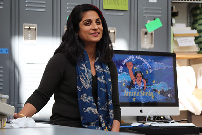 """Guest Artist, Sarah K Khan discussing her character Amrita Simla (image in background) with the students of """"Tactile Textiles – From 2D to 3D."""""""