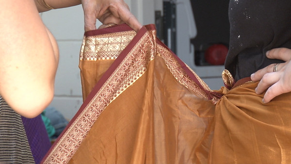 A close up of the saris.
