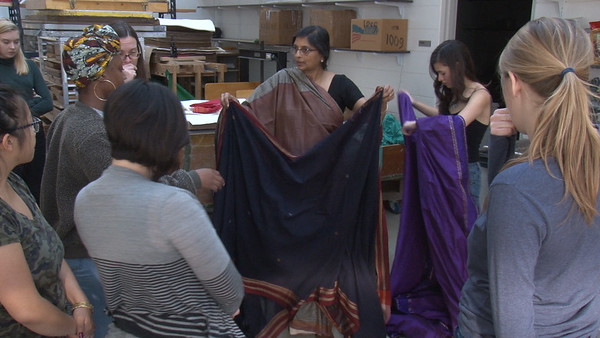 Lakshmi Narayan Kadambi demonstrates draping with students enrolled in Meeta's course.