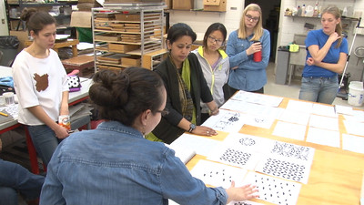 Maria Wood (MFA, Design Studies) discussing her design with the class. Pictured: Meghana Jain Singh, Penny Xiong (Art History, French), Catherine Finedore (COE, Biomedical Engineering), Molly Mapston (Art History), and Lucy Hodkiewicz (Art).