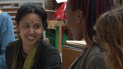 Meghana Jain Singh discussing work with YAYA Giovanni Houston (Textiles and Fashion Design)