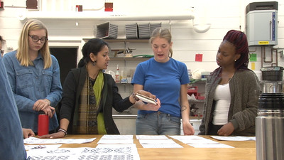 Meghana Jain Singh discussing the print by Lucy Hodkiewicz (Art). Also pictured Molly Mapstone (Art History, French) and YAYA Giovanni Houston (Textiles and Fashion Design)