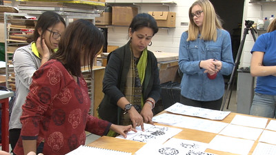 Meeta and Meghana Jain Singh measuring a design. Also pictured Penny Xiong (Art History), Molly Mapstone (Art History, French) and Lucy Hodkiewicz (Art)