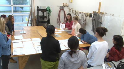 Full view of classroom, as Sarah O'Farrell (MFA, Art) discusses her design.