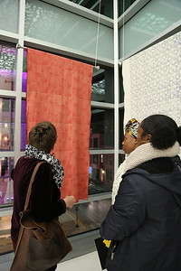 Attendees examine work by YAYA Giovanni Houston (Textiles and Fashion Design)