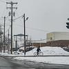 JOED VIERA/STAFF PHOTOGRAPHER Lockport, NY- A cyclist takes a snowy ride down Washburn Street.