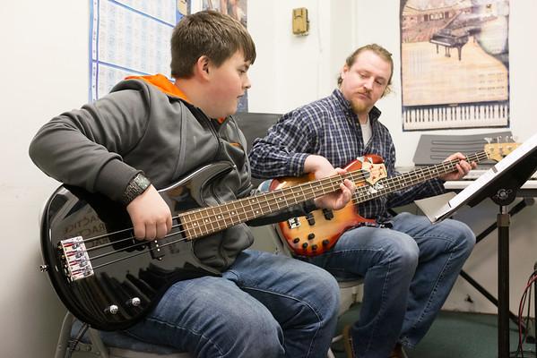 JOED VIERA/STAFF PHOTOGRAPHER-Lockport, NY-Devin Kirkpatrick takes bass guitar lessons from Matt Rutschmann at Tone and Design.