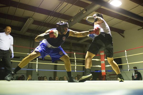 JOED VIERA/STAFF PHOTOGRAPHER Niagara Falls, NY- Rico Hernandez(red) and Nolan Smith(blue) box during a match at Casal's Boxing Gym.