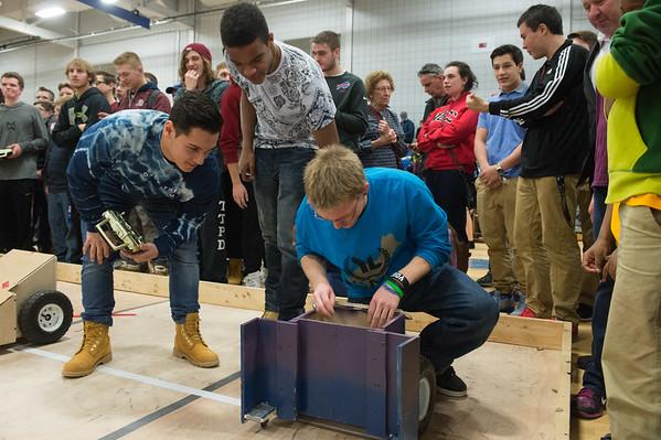 JOED VIERA/STAFF PHOTOGRAPHER Sanborn, NY-Tonawanda High School students fix a robot during the Tech Wars finals at Niagara County Community College.