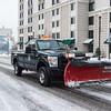 JOED VIERA/STAFF PHOTOGRAPHER Lockport, NY-A Niagara County snowplow rides down Main Street.