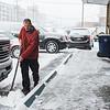 JOED VIERA/STAFF PHOTOGRAPHER Lockport, NY-Tim Kurzdorfer shovels outside of Walnut St. Wine and Liquor.