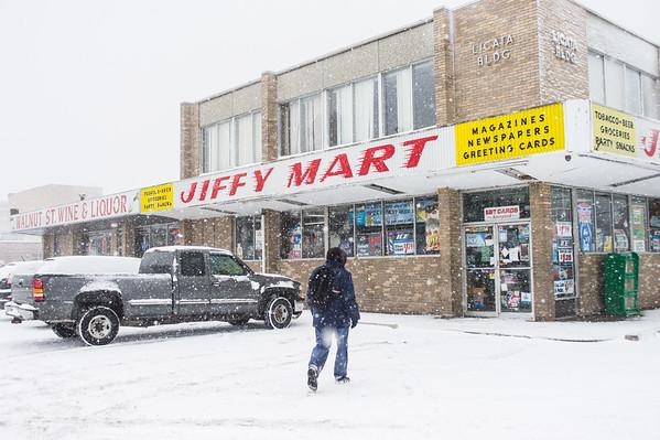JOED VIERA/STAFF PHOTOGRAPHER Lockport, NY-Snow falls over  the Licata Building on Walnut Street.