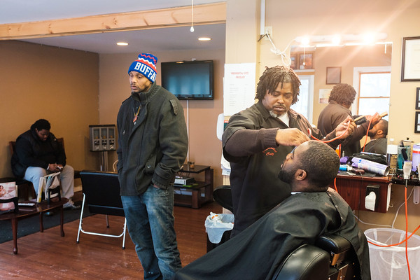 JOED VIERA/STAFF PHOTOGRAPHER Lockport, NY-Community members gather at Presidential Cutz on High Street to discuss the importance of Martin Luther King Jr. and other social issues.