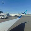 Waiting to leave Calgary on Skywest Delta Connection Bombardier CRJ-900 N822SK with WestJet Boeing 77 C-FRWA beyond.