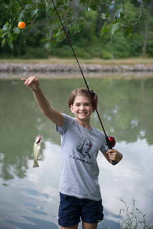 JOED VIERA/STAFF PHOTOGRAPHER- Lockport, NY-McKenna Koch caught a small fish while fishing during the Erie Canal Derby.