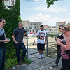 JOED VIERA/STAFF PHOTOGRAPHER- Lockport, NY- A group of friends stop outside of the Erie Canal Discovery Center to catch pokemon.