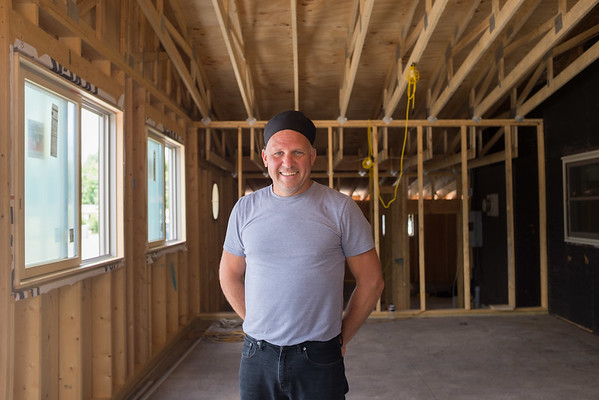 JOED VIERA/STAFF PHOTOGRAPHER- Middleport, NY-Darrell Gilbert stands in the unfinished expansion at Darrell's Place.