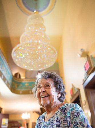 JOED VIERA/STAFF PHOTOGRAPHER- Lockport, NY-Virginia Tracey smiles in front of the Palace Theater's new chandelier.