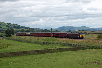 57313 approaches Cross Hills with 5Z47 1050 Carnforth Steamtown - York Yard North R.S. empty stock move for a Harrogate to Blaenau Ffestiniog charter the following day. 47851 is just visible on the rear of the train (12/07/2016)