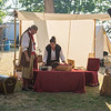 "JOED VIERA/STAFF PHOTOGRAPHER- Olcott, NY-Carla Biggert ""Gabriella"" and David Biggert ""Billy Bones"" set up their tent at the Pirate Festival."