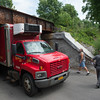JOED VIERA/STAFF PHOTOGRAPHER- Lockport, NY-A poultry truck is stuck after failing to clear the railroad bridge that crosses over Day Road. The truck was ultimately  able to pass after deflating its tires.