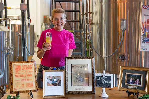 JOED VIERA/STAFF PHOTOGRAPHER-Lockport, NY-Walter Kohl's Daughter Martha Howe holds a glass of Walter Kohl-sch beer at the brewery behind a display dedicated to Kohl's memory.