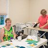 JOED VIERA/STAFF PHOTOGRAPHER- Lockport, NY-Diane Surage and Jan Jordan work on sudoku quilts for the Kenan Quilter Guild's at the Kenan Meeting Room. The 59 member strong Guild meets up every second Thursday of each month and has been around for the past 30 years.