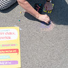 JOED VIERA/STAFF PHOTOGRAPHER-Lockport, NY-Ellen Martin uses chalk to draw on the City parking lots ground to promote Chalkfest.