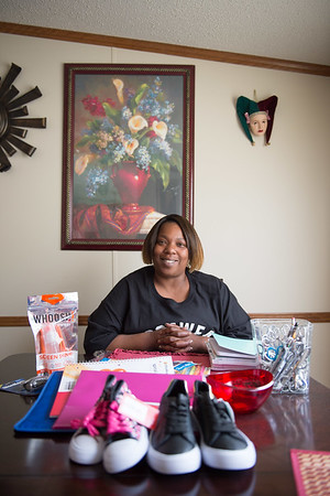 JOED VIERA/STAFF PHOTOGRAPHER-Lockport, NY-  Felicia Patterson sits behind some of the items that will be available at Stepping Up.