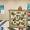 JOED VIERA/STAFF PHOTOGRAPHER- Lockport, NY-Kathy Nyquist holds up a sudoku quilt made for the Kenan Quilter Guild at the Kenan Meeting Room. On average it takes 6-8 hours to complete a quilt. The 59 member strong Guild meets up every second Thursday of each month and has been around for the past 30 years.