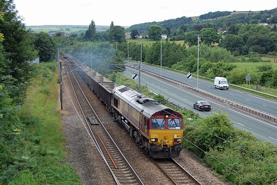 66175 runs alongside the Aire Valley Trunk Road north of Bingley with 6Exx 1415 New Biggin - Milford West Sidings gypsum empties (12/07/2016)