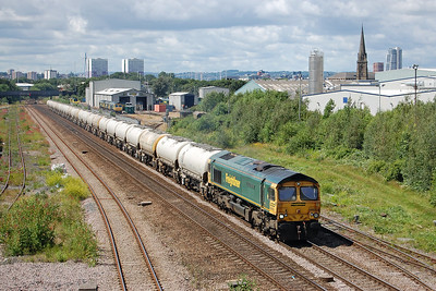 66619 passes Freightliner's Midland Road Depot with 6Mxx 1250 Hunslet Tilcon to Tunstead Sidings empties (05/07/2016)