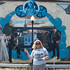 JOED VIERA/STAFF PHOTOGRAPHER-Lockport, NY-Ellen Martin stands in front of the mural to promote Chalkfest.