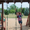JOED VIERA/STAFF PHOTOGRAPHER- Lockport, NY-Lillianna Emmert, 9, hangs at the Day Road Park playground.