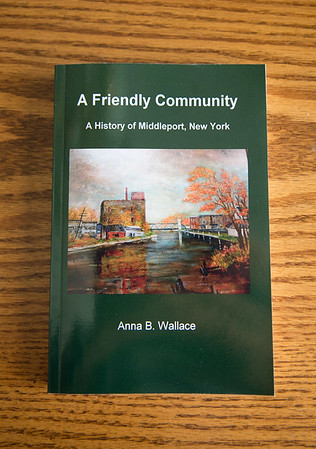 """JOED VIERA/STAFF PHOTOGRAPHER- Middleport, NY- """"A Friendly Community"""" is being sold at the Music in the Park event."""