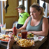 JOED VIERA/STAFF PHOTOGRAPHER- Middleport, NY-Stephanie Williams and her son Nicholas Williams Jr., 2, have a meal at Darrell's Place.