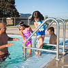 JOED VIERA/STAFF PHOTOGRAPHER- Lockport, NY-Hugo Arroyo helps his children Zaynah, 7, Hannah, 6 and Sean Arroyo, 9, into the Lockport Community Pool.