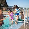JOED VIERA/STAFF PHOTOGRAPHER- Lockport, NY-Hugo Arroyo helps his children Zaynah, 7, Hannah, 6 and Sean Arroyo, 9, into the Lockport Community Pool.