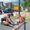 JOED VIERA/STAFF PHOTOGRAPHER- Lockport, NY-Tonawanda based chalk artist Courtney Haeick sets up for Chalkfest at the lower level of the city parking lot. The Festival will feature dozens of artists from around the country.