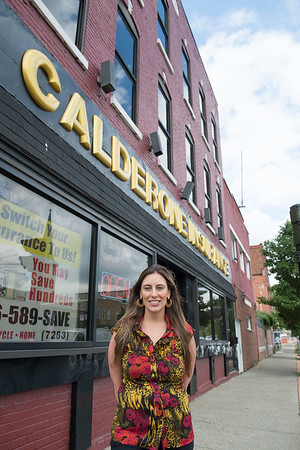 JOED VIERA/STAFF PHOTOGRAPHER-Lockport, NY-  Heather Calderone stands outside of her insurance business on Transit Road and Main Street