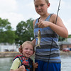 JOED VIERA/STAFF PHOTOGRAPHER-Middleport, NY-Evan Horanburg 5 and his cousin Gabriel Soulvie 13 hold up a catfish they caught while participating in the Erie Canal Derby
