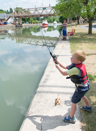 JOED VIERA/STAFF PHOTOGRAPHER-Middleport, NY- Evan Horanburg 5 casts his rod into the Erie Canal in hopes of catching a Derby winning fish.