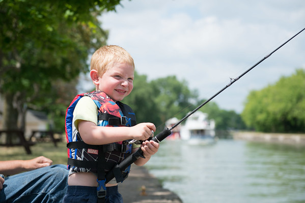 JOED VIERA/STAFF PHOTOGRAPHER-Middleport, NY-Evan Horanburg 5 tries to reel in a Derby winning fish from the Erie Canal